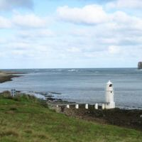 Lighthouse on Calf Sound, Eday. The land on the upper right of the picture is the northern tip of the Calf of Eday. by Rob Burke is licensed under CC BY-SA 4.0